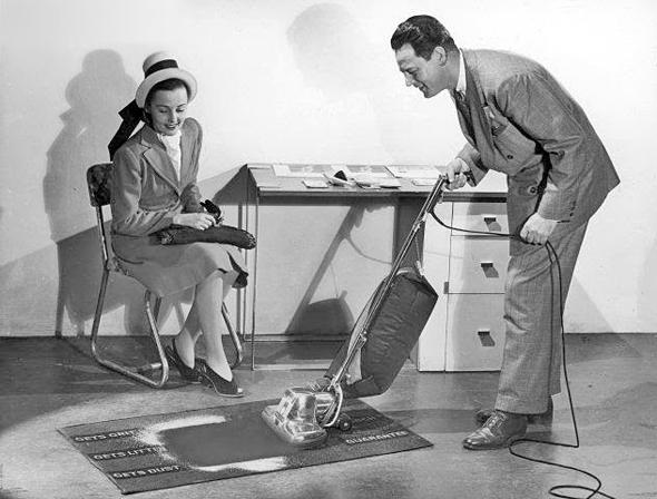 A Kirby vacuum salesman completes his sales presentation